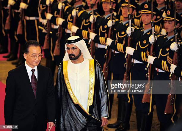 Visiting United Arab Emirates Prime Minister Sheikh Mohammad bin Rashed alMaktoum walks beside Chinese Premier Wen Jiabao during a review of the...