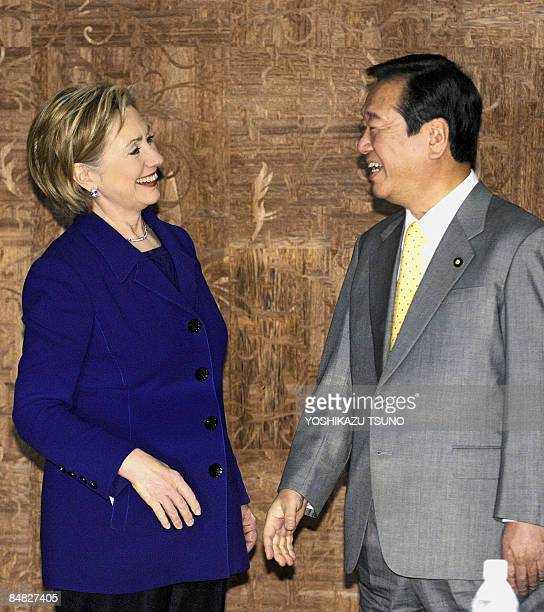 Visiting US Secretary of State Hillary Clinton laughs with Japan's main opposition Democratic Party of Japan leader, Ichiro Ozawa, prior to their...