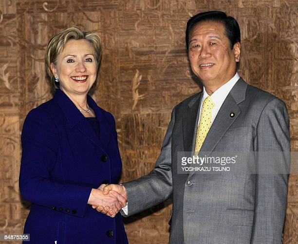 Visiting US Secretary of State Hillary Clinton shakes hands with Japan's main opposition Democratic Party of Japan leader, Ichiro Ozawa, prior to...