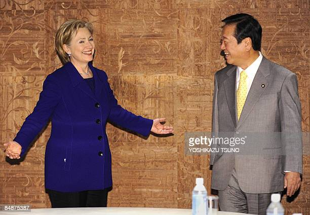 Visiting US Secretary of State Hillary Clinton shares a smile with Japan's main opposition Democratic Party of Japan leader, Ichiro Ozawa, prior to...
