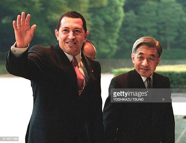 Visiting Venezuelan President Hugo Chavez is greeted by Japanese Emperor Akihito upon his arrival at the Imperial Palace in Tokyo 13 October 1999...