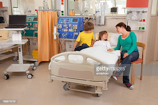 visiting young patient in hospital - dialysis stock pictures, royalty-free photos & images