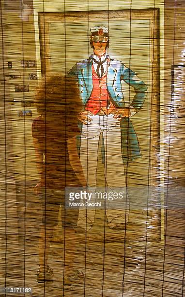 A visitor admires a poster depicting Corto Maltese at the newly opened House of Corto Maltese on July 4 2011 in Venice Italy Corto Maltese is a...