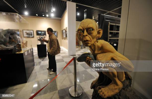 A visitor admires a prop used in movie 'The Lord of the Rings' during the 'The Exceptional Exhibition' at the Sichuan Museum on December 4 2009 in...