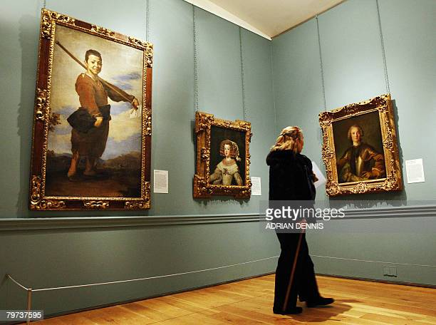A visitor admires paintings Jose de Ribera's Le Piedbot Diego Velazquez's Portrait of the Infanta Maria Theresa of Spain and JeanMarc Nattier's...
