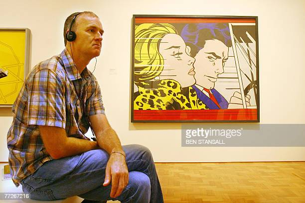 A visitor admires Roy Lichtenstein's 'In The Car 1963' at the Pop Art Portraits exhibition National Portrait Gallery in central London 11 October...