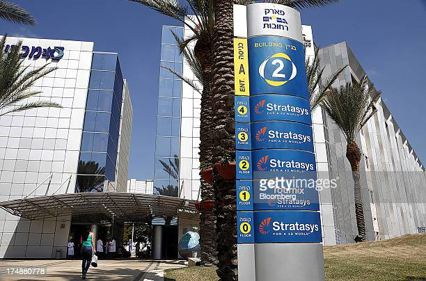 A visitor approaches the entrance to the offices of Stratasys Ltd manufacturer of 3D printing machines in Rehovot Israel on Sunday July 28 2013...