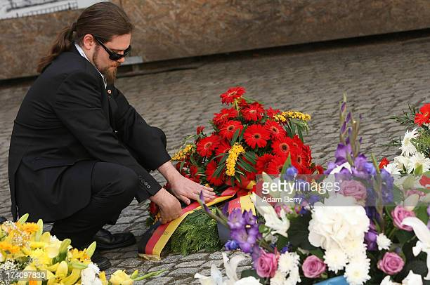 A visitor arranges flowers at a memorial to the 1944 assassination attempt on Adolf Hitler on the 69th anniversary of the failed mission on July 20...