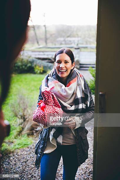 visitor arriving with a gift - visit stock pictures, royalty-free photos & images