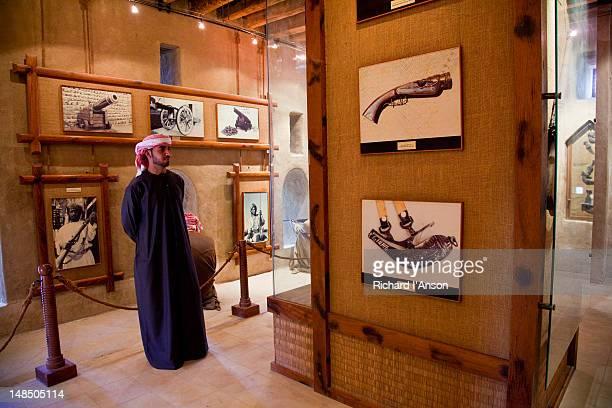 visitor at hatta heritage village. - solo un uomo di età media foto e immagini stock