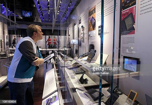 Visitor at the Computer History Museum looks at a display of hand held computers on January 19, 2011 in Mountain View, California. After a two year,...