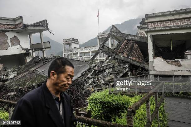 A visitor at the memorial site of the 2008 Sichuan earthquake of Xuankou Middle School in Yingxiu town on 30th March 2018 in Yingxiu Ngawa Tibetan...