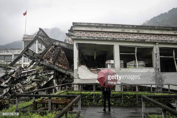 A visitor at the memorial site of the 2008 Sichuan earthquake of Xuankou Middle School on 30th March 2018 in Yingxiu Ngawa Tibetan and Qiang...
