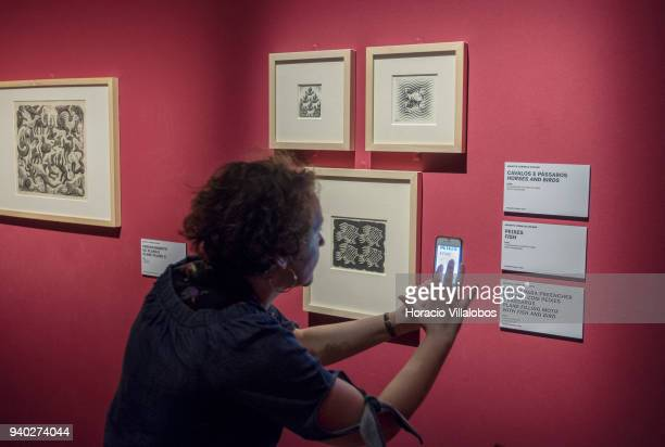 A visitor at the Museu de Arte Popular takes in the work of Dutch artist Maurits Cornelis Escher on March 30 2018 in Lisbon Portugal This exhibition...