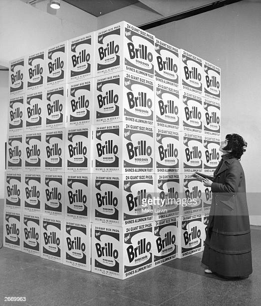 A visitor at the Tate gallery in London inspecting Andy Warhol's work entitled 'The Brillo Boxes'
