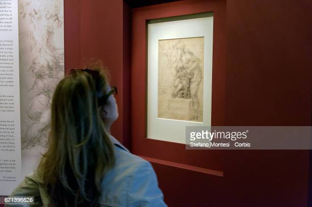 A visitor attends an exhibition opened to the public for the first time in which two newly found two drawings by Michelangelo 'The Sacrifice of...
