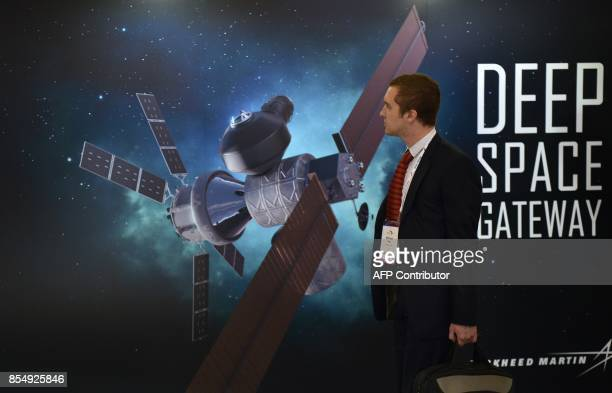 A visitor attends the 68th International Astronautical Congress 2017 in Adelaide on September 28 2017 The 68th International Astronautical Congress...