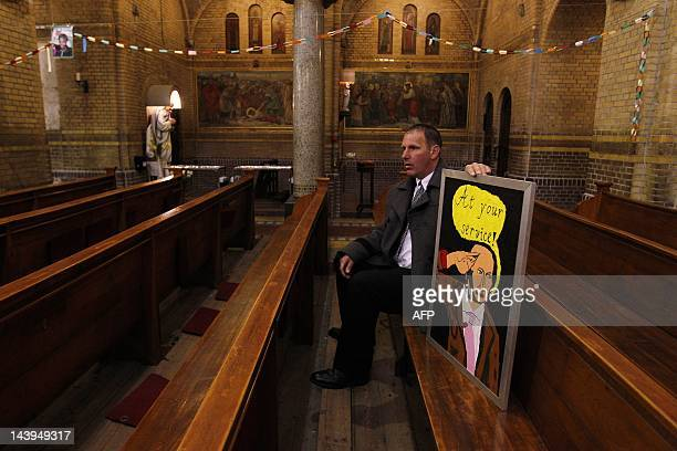 A visitor attends the memorial mass for the Dutch rightwing politician Pim Fortuyn at the Laurentiuskerk in Rotterdam on May 6 2012 Fortuyn was...