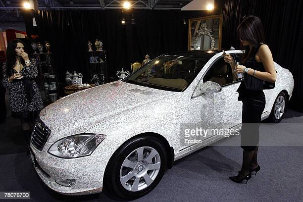 Visitor attends the Millionaire Fair 2007 at Crocus Expo November 22, 2007 in Moscow, Russia. The Millionaire Fair, the world's largest exhibit of...