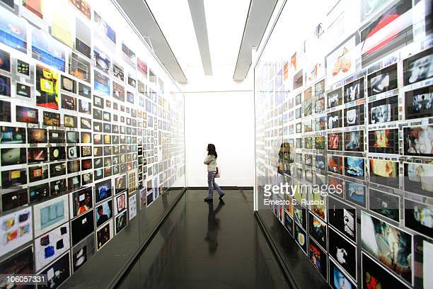 A visitor attends the opening of new exhibitions at the Museum of Contemporary Art of Rome during the 5th International Rome Film Festival on October...