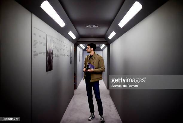 A visitor attends the 'Time Capsule' by Louis Vuitton Exhibition on April 16 2018 in Madrid Spain