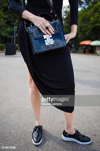 A visitor bag detail poses during Sao Paulo Fashion Week Trans 42 SPFW Fall / Winter 2017 on October 26 2016 in Sao Paulo Brazil