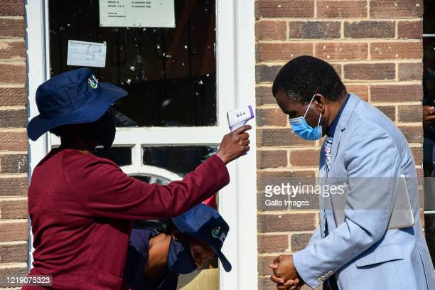 Visitor being temperature screened during the Kzn Premier's visit to Ohlange High School to monitor whether they are adequately prepared to deal with...