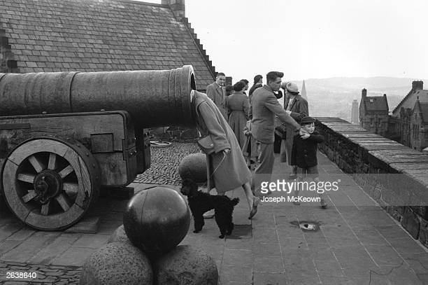 A visitor bravely puts her head inside a cannon on the ramparts of Edinburgh Castle The cannon is the famous 15thcentury gun named Mons Meg which is...