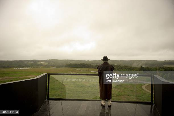 A visitor braves the rain at the visitor center at the Flight 93 National Memorial on September 10 2015 in Shanksville Pennsylvania The newly opened...