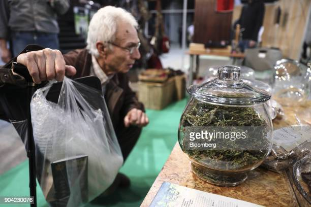 A visitor browses marijuana products on display at the 1st International Cannabis Expo at the Faliro Sports Pavilion in Athens Greece on Friday Jan...