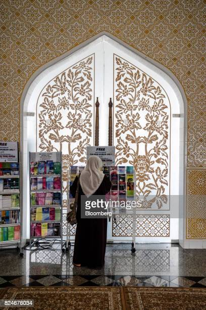 A visitor browses religious reading materials at the Crystal Mosque in Kuala Terengganu Terengganu Malaysia on Monday July 23 2017 With a federal...
