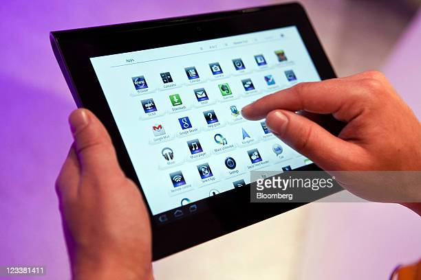 A visitor browses the app store on Sony Corp's new Androidbased tablet computer the Sony Tablet S while on display at the IFA consumer electronics...