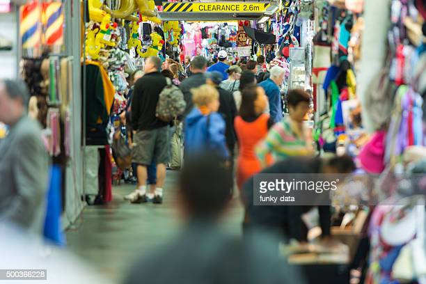 visitor buying at the paddy's market sydney - editorial stock pictures, royalty-free photos & images