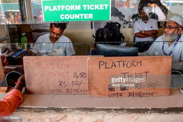 Visitor buys a platform train ticket, of price has been increased four times as an attempt to bring down the visiting crowd amid concerns over the...