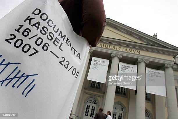 A visitor carries a Documenta 12 bag on in front of the Fridericianum museum during the Documenta exhibition photocall on June 13 2007 in Kassel...