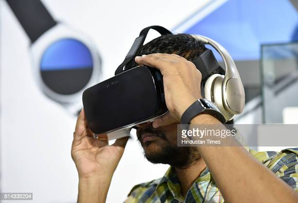 A visitor checking Samsung Gear VR during Samsung Galaxy S7 and Galaxy S7 Edge smartphones during their launch on March 8 2016 in New Delhi India