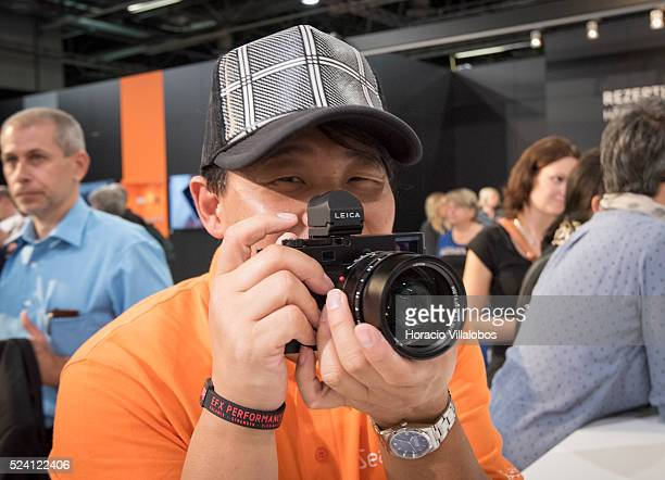 A visitor checks an M model at Leica pavilion in Photokina 2014 in Cologne Germany 18 September 2014 Photokina the world's leading imaging fair...