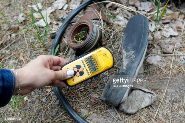 A visitor checks for radiation levels via a dosimeter at the Chernobyl exclusion zone in the abandoned city of Pripyat The HBO television miniseries...
