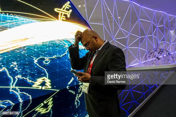 A visitor checks his phone during the second day of the Mobile World Congress 2015 at the Fira Gran Via complex on March 3 2015 in Barcelona Spain...