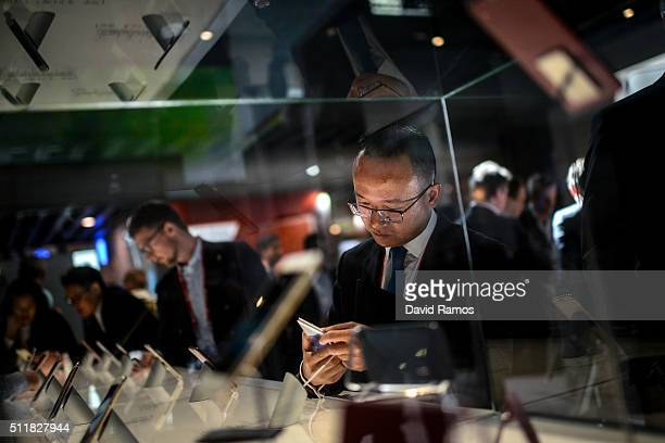 A visitor checks HTC mobile phones on the second day of the event at the Fira Gran Via Complex on day 2 of the Mobile World Congress on February 23...