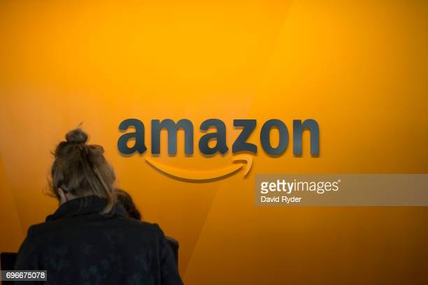 A visitor checks in at the Amazon corporate headquarters on June 16 2017 in Seattle Washington Amazon announced that it will buy Whole Foods Market...