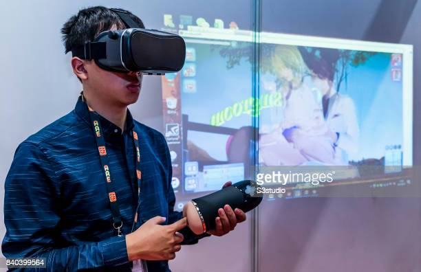 Visitor checks out a Virtual Reality adult sex game with game masturbation cup during the Asia Adult Expo 2017 at the Hong Kong Convention and...