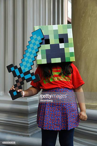 A visitor dressed as a Minecraft creeper character poses for a photograph at the Legends of Gaming Live event in London on Saturday Sept 5 2015 The...
