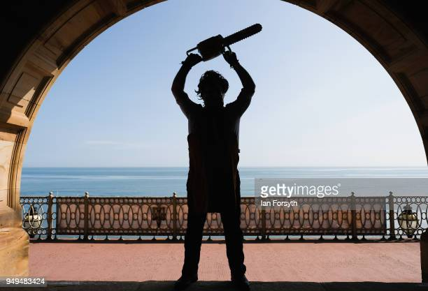 Visitor dressed as the character Leatherface from the movie Texas Chainsaw Massacre poses during the Scarborough Sci-Fi event held at the seafront...