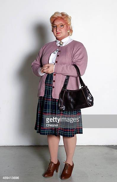 A visitor dressed costume of character Mrs Doubtfire poses during the Paris Comics Expo on November 22 2014 in Paris France This event promotes...