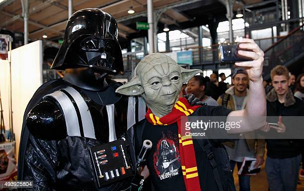 A visitor dressed with the costum of character Yoda takes a selfie with the character of Darth Vader from the Star Wars series in the first edition...