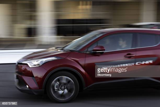 A visitor drives a Toyota Motor Corp CHR vehicle during a test drive at the company's Mega Web car theme park in Tokyo Japan on Friday Feb 3 2017...