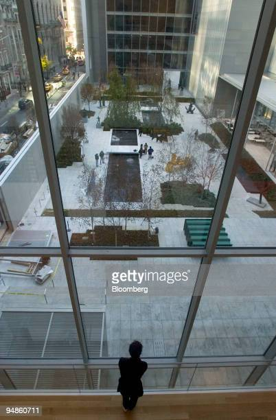 A visitor during a media preview looks out over The Abby Aldrich Rockefeller Sculpture Garden in The Museum of Modern Art MoMA in New York on...