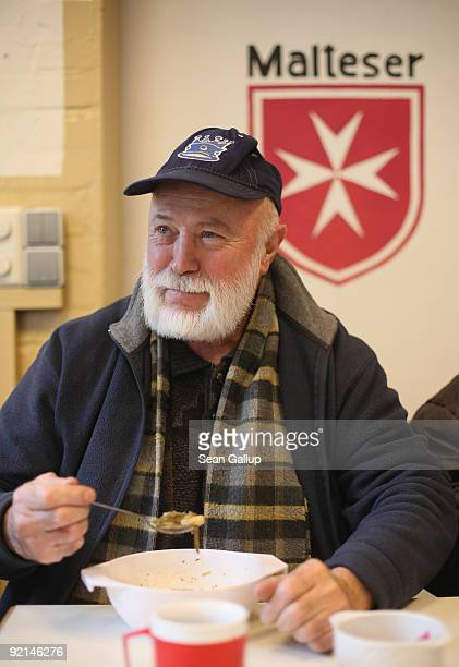 A visitor eats hot soup at a soup kitchen of the Malteser charity part of the Order of Malta Worldwide Relief on October 21 2009 in Berlin Germany...