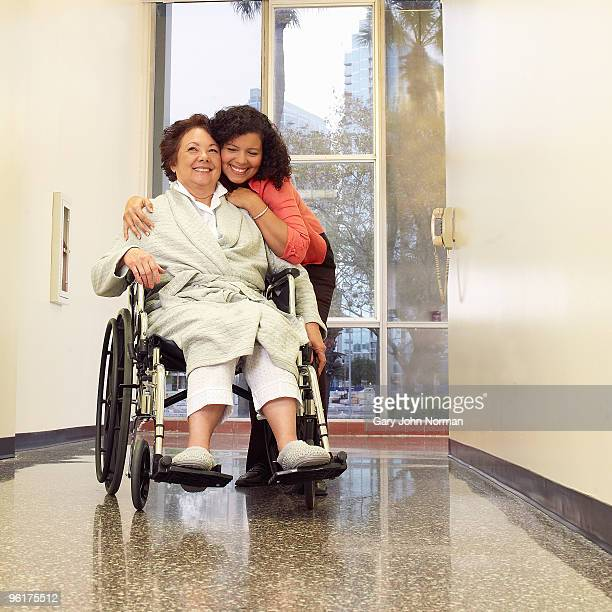 Visitor embraces relative in hospital